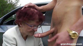 Sjort haired redhead granny gives a sloppy blowjob POV in a automobile
