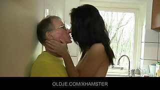 Young girl fucks hard the Old man less the kitchen