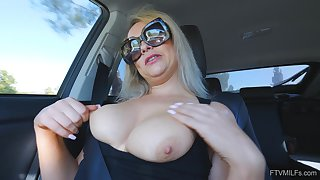 Amateur solo flaxen-haired MILF Elle masturbates in a car wearing glasses