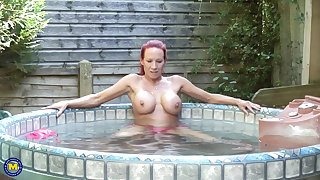 Busty grown up redhead MILF Faye exposes her huge fixed tits