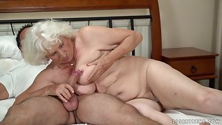 Horny granny gets her pussy serviced by a young tramp